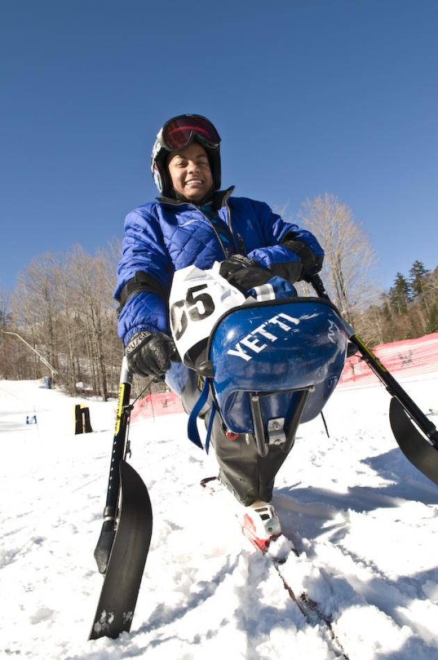 Anjali sitting in mono-ski at the base of Waterville Valley World Cup trail