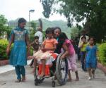 This is how Anjali gets around India...with kids piled on her lap and pushing