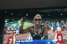 Anjali Forber-Pratt on the big screen at the Beijing Olympics