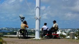 Looking out over Bermuda, Anjali and a man in a power chair.